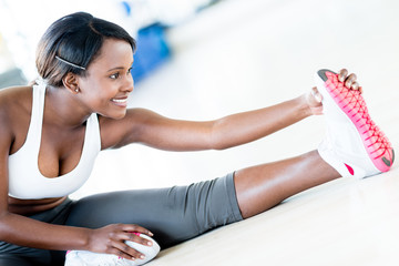Fit woman stretching