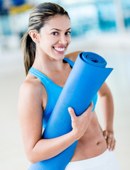Gym woman holding yoga mat