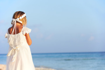 Bridesmaid Standing On Beach At Wedding Ceremony