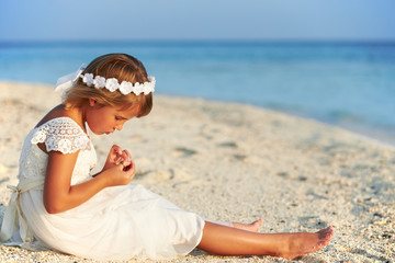 Bridesmaid Sitting On Beach At Wedding Ceremony