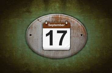 Old wooden calendar with September 17.