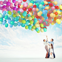 Family holding colorful balloons