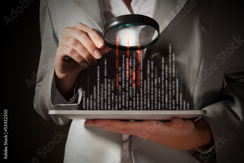 Businesswoman with magnifier glass
