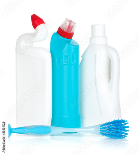 Plastic bottles of cleaning products and brush