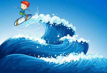 A little boy surfing at the sea