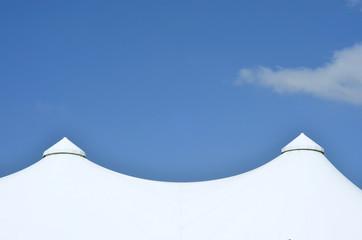 big festive tents against blue sky