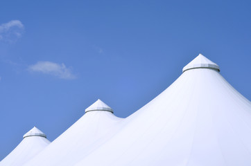 big festive tents against blue sky