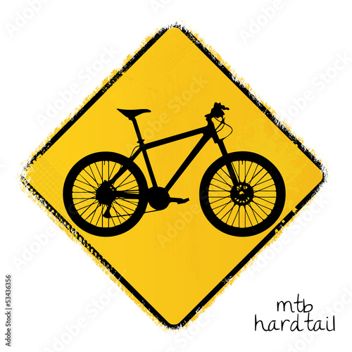 warning road sign with a hardtail mountainbike