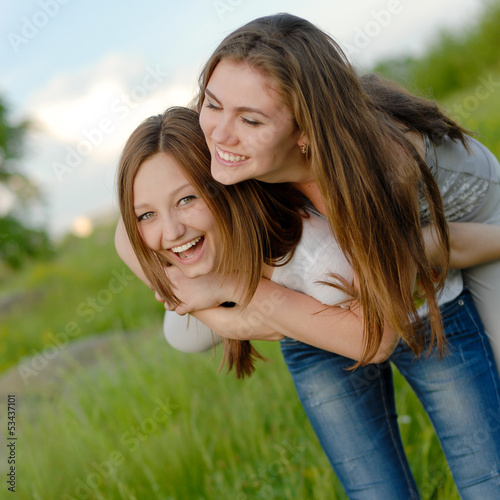 Two Teen Girl Friends Laughing  in spring or summer