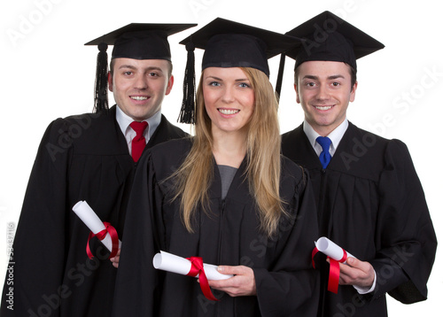 Three graduate with scrolls against a white background