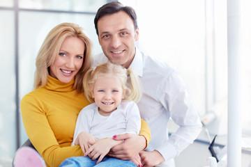 Family in dental clinic