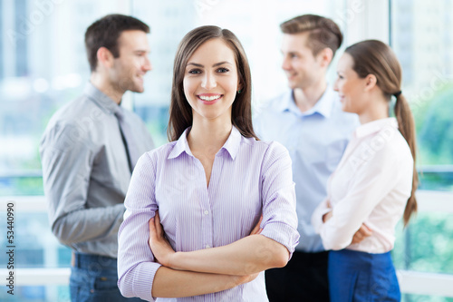 Businesswoman with coworkers in background