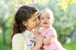cute mother with baby girl outdoors