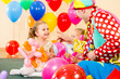 happy kids and clown on birthday party