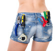 Beautiful female worker with tools in back pocket on shorts