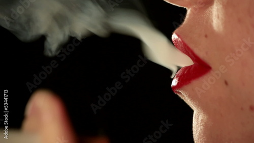 Close up of woman mouth smoking. Find similar in our portfolio.