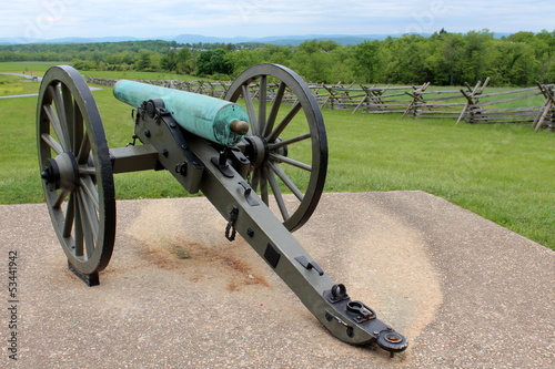 Old Civil War canon displayed on concrete slab