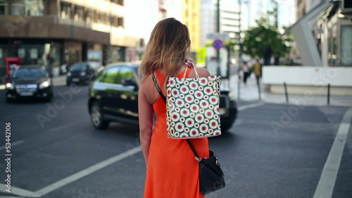 Woman with shopping bags standing by the street
