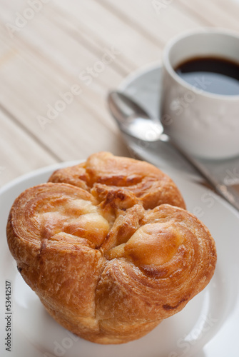 Muffin served with hot black coffee