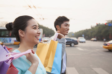 Young couple walking down the street with shopping bags in Beijing