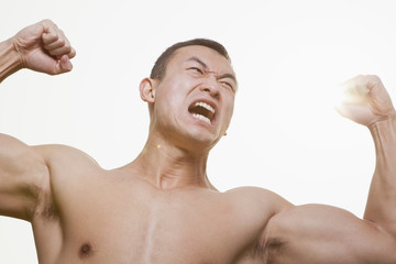 Roaring Man Flexing Muscles
