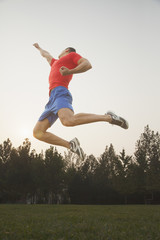 Muscular Man Jumping