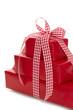 Geschenk oder Paket in Rot mit Schleife kariert