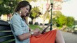 Beautiful woman with tablet computer in the park, steadicam shot