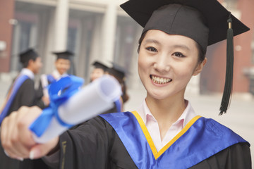 Young Female Graduate Holding Diploma