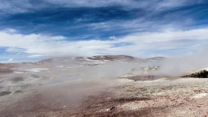 Geyser field El Tatio in back lighting, Atacama region, Chile