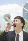 Mid Adult Businessman with Megaphone