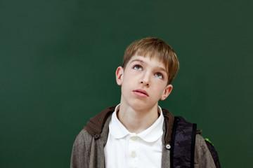 Portrait of student at blackboard background