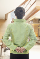 Restaurant/Hotel Hostess in Traditional Chinese Clothing, View From Behind