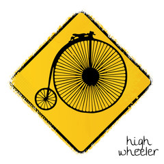 warning road sign with a penny-farthing bike