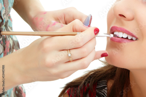 poster of esthetician apply lipstick on female lips closeup