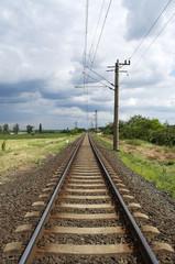 Straight railway leads to the horizon