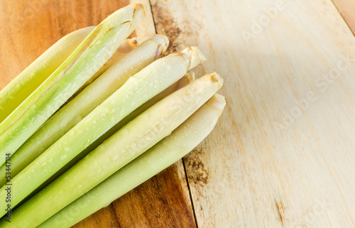Fresh lemongrass on wood background