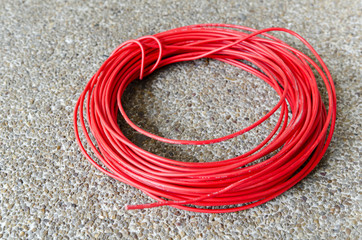 Red hot power cable on sand floor