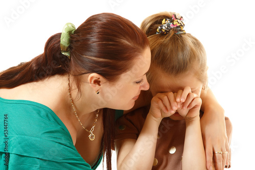 mother console her crying daughter