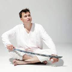 man wielding a sword.