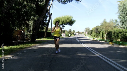 Woman running slow motion on street wide shot