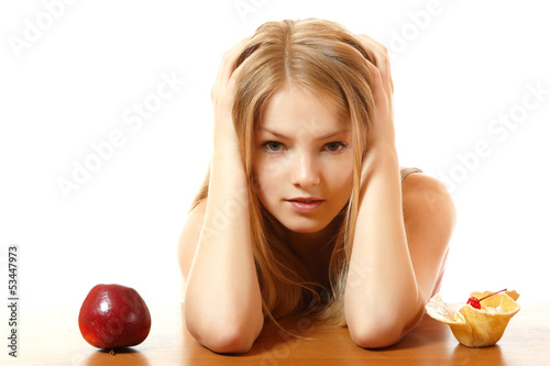 diet girl with cake or apple