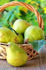 Ripe pears on basket