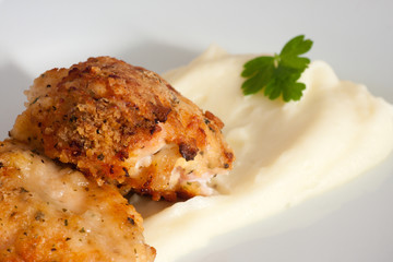 chicken covered with cracker crumbs with potato mash