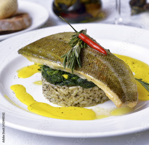 sea ​​bass with risotto and spinach