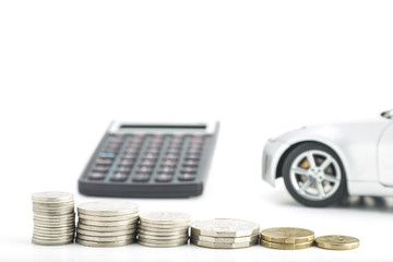 Coins with car and calculator