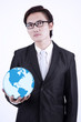 Businessman hold globe on white background
