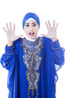 Excited female muslim in blue dress - isolated