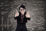 Happy businesswoman show thumbs up in class