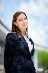 Beautiful young female executive in a modern setting